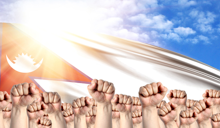 Labor Day concept with fists of men against the background of the flag of Nepal Stock Photo