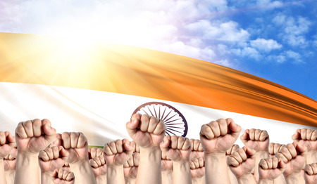 Labor Day concept with fists of men against the background of the flag of India