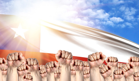Labor Day concept with fists of men against the background of the flag of Chile Stock Photo