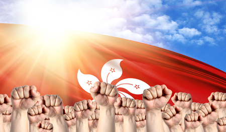 Labor Day concept with fists of men against the background of the flag of Hong Kong