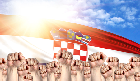 Labor Day concept with fists of men against the background of the flag of Croatia Stock Photo