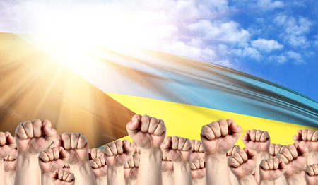 Labor Day concept with fists of men against the background of the flag of Bahamas Stock Photo