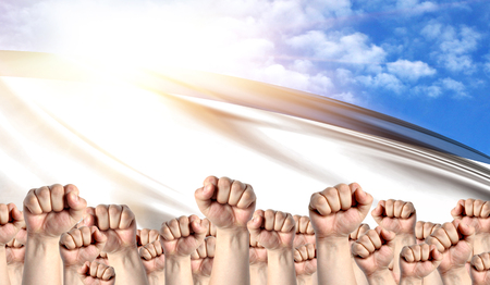 Labor Day concept with fists of men against the background of the flag of Crimea Stock Photo