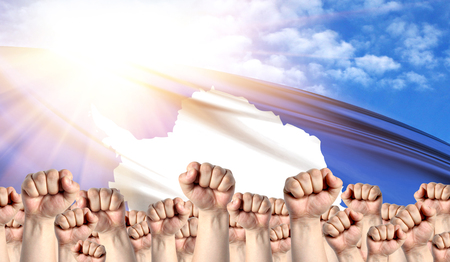 Labor Day concept with fists of men against the background of the flag of Antarctic