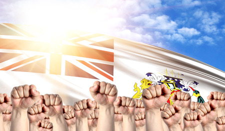 Labor Day concept with fists of men against the background of the flag of British Antarctic Territory Stock Photo