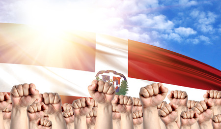 Labor Day concept with fists of men against the background of the flag of Dominican Republic Stock Photo