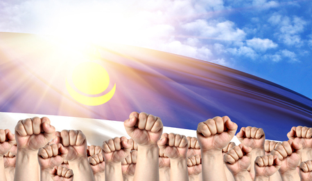 Labor Day concept with fists of men against the background of the flag of Buryatia Stock Photo