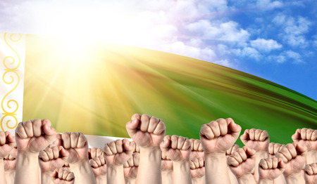 Labor Day concept with fists of men against the background of the flag of Chechen Republic Stock Photo
