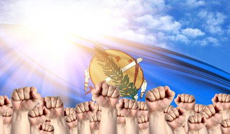 Labor Day concept with fists of men against the background of the flag State of Oklahoma Stock Photo