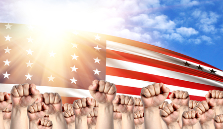Labor Day concept with fists of men against the background of the flag of Bikini Atoll