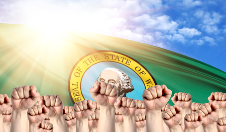 Labor Day concept with fists of men against the background of the flag State of Washington
