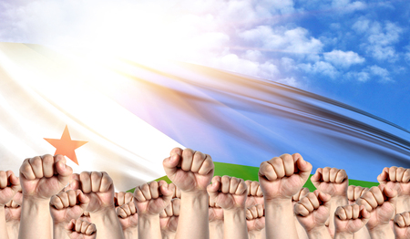 Labor Day concept with fists of men against the background of the flag of Djibouti