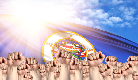 Labor Day concept with fists of men against the background of the flag State of Minnesota