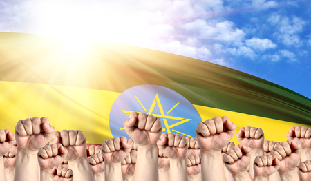 Labor Day concept with fists of men against the background of the flag of Ethiopia Stock Photo