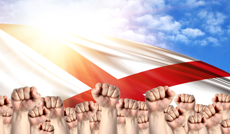 Labor Day concept with fists of men against the background of the flag State of Alabama