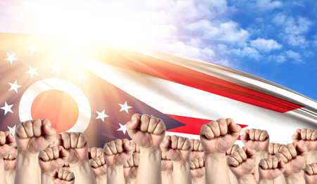 Labor Day concept with fists of men against the background of the flag State of Ohio Stock Photo