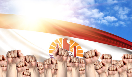 Labor Day concept with fists of men against the background of the flag of French Polynesia
