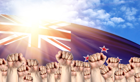 Labor Day concept with fists of men against the background of the flag of New Zealand Stock fotó