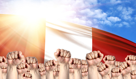 Labor Day concept with fists of men against the background of the flag of Peru