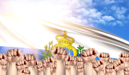 Labor Day concept with fists of men against the background of the flag of San marino Stock Photo