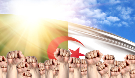 Labor Day concept with fists of men against the background of the flag of Algeria Stock Photo