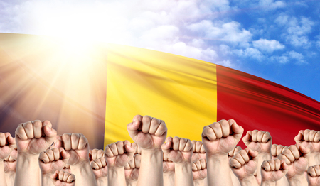 Labor Day concept with fists of men against the background of the flag of Chad