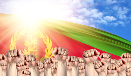 Labor Day concept with fists of men against the background of the flag of Eritrea Stock Photo