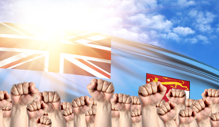 Labor Day concept with fists of men against the background of the flag of Fiji
