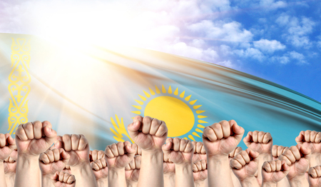 Labor Day concept with fists of men against the background of the flag of Kazakhstan Stock Photo