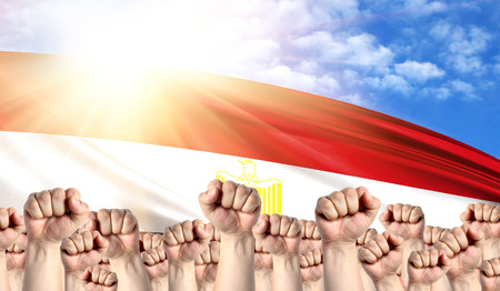 Labor Day concept with fists of men against the background of the flag of Egypt Stockfoto
