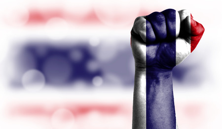 Flag of Costa Rica painted on male fist, strength,power,concept of conflict. On a blurred background with a good place for your text.