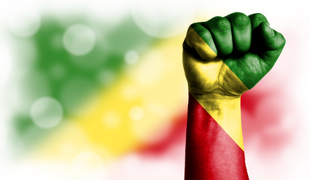 Flag of Congo,Republic painted on male fist, strength,power,concept of conflict. On a blurred background with a good place for your text. Stock Photo