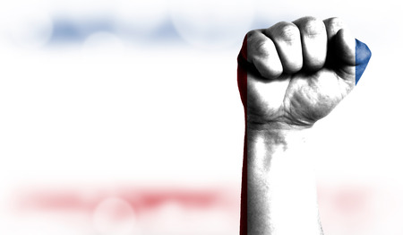 Flag of Crimea painted on male fist, strength,power,concept of conflict. On a blurred background with a good place for your text.