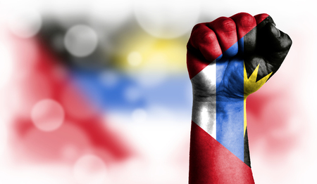 Flag of Antigua and Barbuda painted on male fist, strength,power,concept of conflict. On a blurred background with a good place for your text. Stock Photo