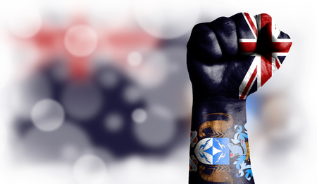 Flag of Tristan da Cunha painted on male fist, strength,power,concept of conflict. On a blurred background with a good place for your text.