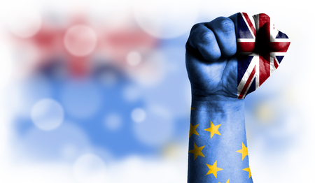 Flag of Tuvalu painted on male fist, strength,power,concept of conflict. On a blurred background with a good place for your text. Stock Photo