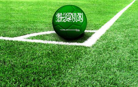 soccer ball on a green field, flag of Saudi Arabia