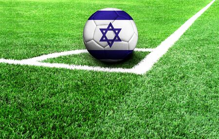soccer ball on a green field, flag of Israel 스톡 콘텐츠