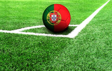 soccer ball on a green field, flag of Portugal