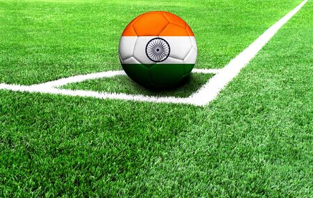 soccer ball on a green field, flag of India