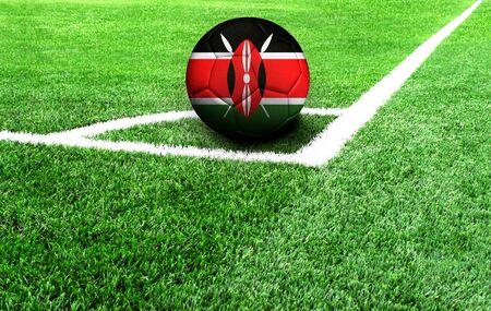 soccer ball on a green field, flag of Kenya