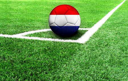 soccer ball on a green field, flag of Netherlands