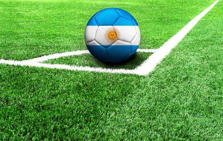 soccer ball on a green field, flag of Argentina Standard-Bild