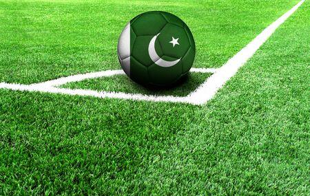 soccer ball on a green field, flag of Pakistan
