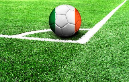 soccer ball on a green field, flag of Ireland