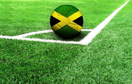 soccer ball on a green field, flag of Jamaica Stockfoto