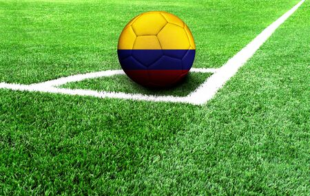 soccer ball on a green field, flag of Colombia Standard-Bild