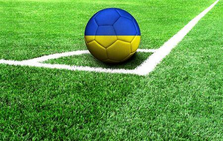 soccer ball on a green field, flag of Ukraine