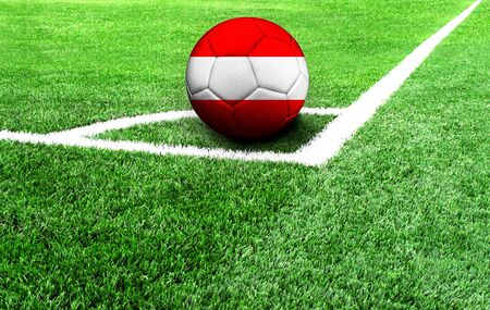 soccer ball on a green field, flag of Austria Stockfoto
