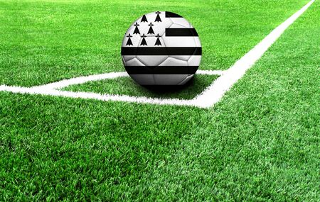 soccer ball on a green field, flag of Brittany
